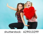 happy two teenager women... | Shutterstock . vector #629013299
