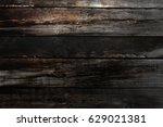 abstract dark wooden background | Shutterstock . vector #629021381