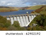 Craig Goch reservoir with water overflowing, Elan Valley, Wales. - stock photo