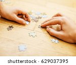 little kid playing with puzzles ... | Shutterstock . vector #629037395