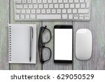 smartphone at the desktop with... | Shutterstock . vector #629050529