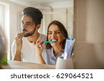 shot of a happy couple bonding... | Shutterstock . vector #629064521
