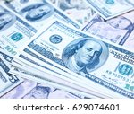 one hundred dollars bills... | Shutterstock . vector #629074601