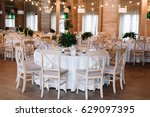 guest table  with bouquet from... | Shutterstock . vector #629097395