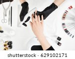 nail tech filing nails with... | Shutterstock . vector #629102171