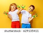 joyful children with paints on... | Shutterstock . vector #629135411