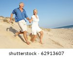 senior couple enjoying beach... | Shutterstock . vector #62913607