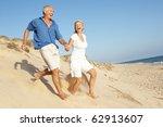 senior couple enjoying beach... | Shutterstock . vector #62913607