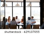 team in a business boardroom... | Shutterstock . vector #629137055
