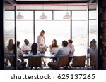 woman standing at a meeting in... | Shutterstock . vector #629137265