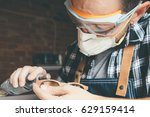 young artisan in protective... | Shutterstock . vector #629159414