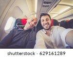 happy couple taking selfie... | Shutterstock . vector #629161289