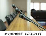 microphone in conference room. | Shutterstock . vector #629167661