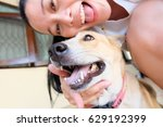 woman selfie with dog | Shutterstock . vector #629192399