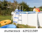 above ground pool with children ... | Shutterstock . vector #629221589