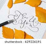 yellow leaves and a pen on a... | Shutterstock . vector #629226191