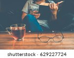 a glass of tea on table with...   Shutterstock . vector #629227724