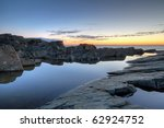 Rocks and water along the Newfoundland coastline at sunrise. - stock photo