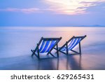Two Beach Chairs On The...