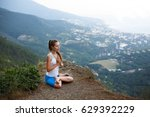 young woman meditating outdoors ... | Shutterstock . vector #629392229