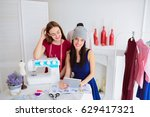 smiling seamstress looks at the ... | Shutterstock . vector #629417321