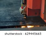 metal cutting with laser | Shutterstock . vector #629445665