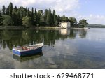 Small photo of Boat and abandoned house
