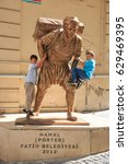 Small photo of Turkey, Istanbul, Sultanahmet district of Old Istanbul, bronze statue of a hard working porter (Hamal) with children playing on it. 2016-01-15