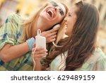 two beautiful young women... | Shutterstock . vector #629489159