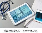 white tablet pc and doctor... | Shutterstock . vector #629495291