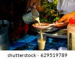 men pouring cup hot tea indian... | Shutterstock . vector #629519789