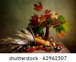 Still Life Autumn concept image with chestnuts corn and maple leafs - stock photo