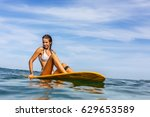 beautiful fit surfing lady in... | Shutterstock . vector #629653589