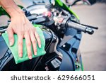 hand with man cleaning... | Shutterstock . vector #629666051