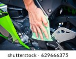 hand with man cleaning... | Shutterstock . vector #629666375
