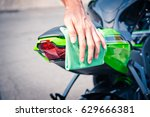 hand with man cleaning... | Shutterstock . vector #629666381