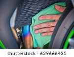 hand with man cleaning... | Shutterstock . vector #629666435