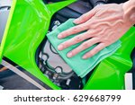 hand with man cleaning... | Shutterstock . vector #629668799