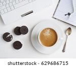 a cup of coffee next to the... | Shutterstock . vector #629686715