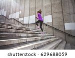 young sporty woman running... | Shutterstock . vector #629688059