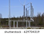 Small photo of Surge arresters on a high voltage line,picture from the North of Sweden.