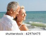 senior couple enjoying beach... | Shutterstock . vector #62976475