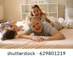 grandmother enjoying in bed... | Shutterstock . vector #629801219