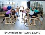 group of women exercising on... | Shutterstock . vector #629812247