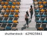 two sportswomen running on... | Shutterstock . vector #629825861