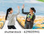 two young sportswomen with... | Shutterstock . vector #629835941