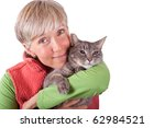 woman lovingly hugging grey cat on white - stock photo