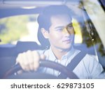 young asian man driving a... | Shutterstock . vector #629873105