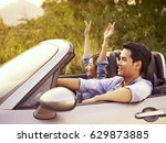 young asian couple riding in a... | Shutterstock . vector #629873885