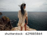 young woman standing on cliff's ...   Shutterstock . vector #629885864